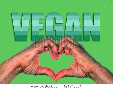 Hands making heart over green background for vegan or veganism environmental concept