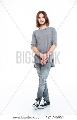 Full lenght of handsome young man with long hair standing over white background