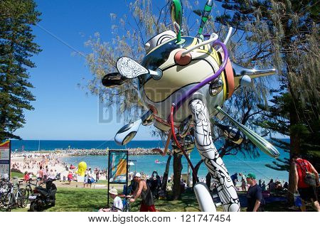 COTTESLOE,WA,AUSTRALIA-MARCH 12,2016:  Whimsical sculpture overlooking the tourists enjoying the interactive public arts festival Sculptures By The Sea at Cottesloe Beach in Cottesloe, Western Australia.