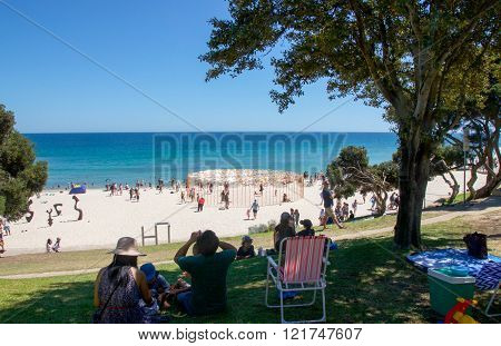 COTTESLOE,WA,AUSTRALIA-MARCH 12,2016: Tourists with elevated view at the
