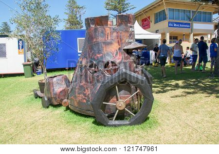 COTTESLOE,WA,AUSTRALIA-MARCH 12,2016: Steam punk patchwork metal cart sculpture with tourists at the