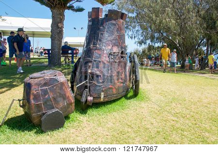 COTTESLOE,WA,AUSTRALIA-MARCH 12,2016: Metal cart patchwork sculpture with tourists at the
