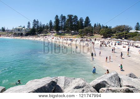 COTTESLOE,WA,AUSTRALIA-MARCH 12,2016: Families at Cottesloe Beach with sculptures at the