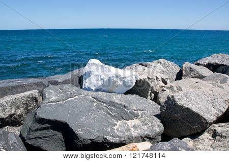 COTTESLOE,WA,AUSTRALIA-MARCH 12,2016: Lone white sculpture on breakwater at the