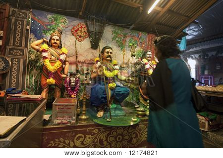 KUALA LUMPUR, MALAYSIA - NOVEMBER 5: Devotees pray to deity Hanuman on Diwali festival day on November 5, 2010 at the Hanuman Temple in Kuala Lumpur. Diwali celebrates the triumph of good over evil.