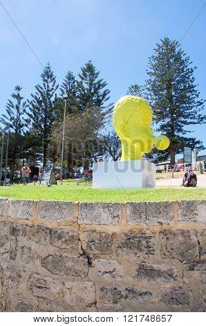 COTTESLOE,WA,AUSTRALIA-MARCH 12,2016:  Yellow head blowing a bubble sculpture at the arts festival