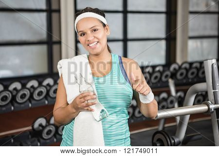 Smiling woman in sportswear in the gym