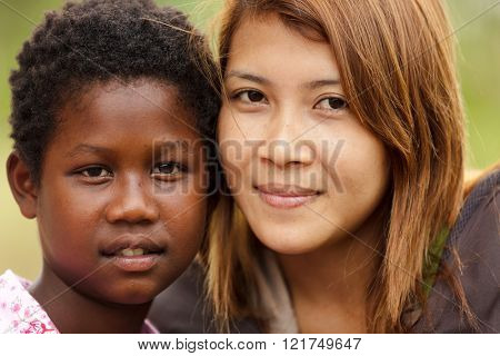 SATUN, THAILAND, DECEMBER 09, 2011 : Portrait of Thai woman and a child from a different ethnicity in a social school orphanage in Satun, Thailand,