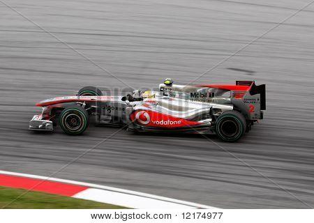 KUALA LUMPUR - APRIL 4: McLaren Mercedes driver Lewis Hamilton takes the hair-pin turn on race day at the 2010 Petronas Malaysia Grand-Prix on April 4, 2010 in Sepang International Circuit, Malaysia.