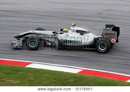 KUALA LUMPUR - APRIL 4: Mercedes GP driver Nico Rosberg takes the hairpin turn on race day at the 2010 Petronas Malaysia Grand-Prix on April 4, 2010 in Sepang International Circuit, Malaysia.