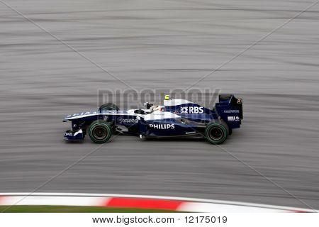 KUALA LUMPUR - APRIL 4: Williams-Cosworth driver Nico Hulkenberg takes the hairpin turn at turn 15 on race day at the 2010 Petronas Malaysia Grand-Prix  April 4, 2010 in Sepang International Circuit.
