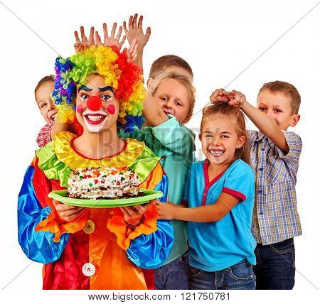 Clown keep cake on birthday with group children. Clown and children posing at camera. Isolated.