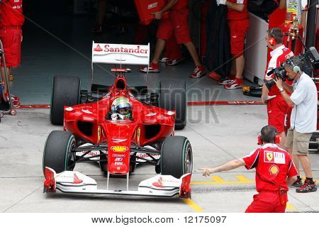 KUALA LUMPUR - APRIL 2: Ferrari's driver Felipe Massa exits the garage for his practice laps on practice day at the 2010 Petronas Malaysia F1 Grand-Prix on April 2, 2010 in Sepang, Malaysia.