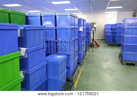 blue Plastic box products in Industrial factory room Container of finished goods germ-free.