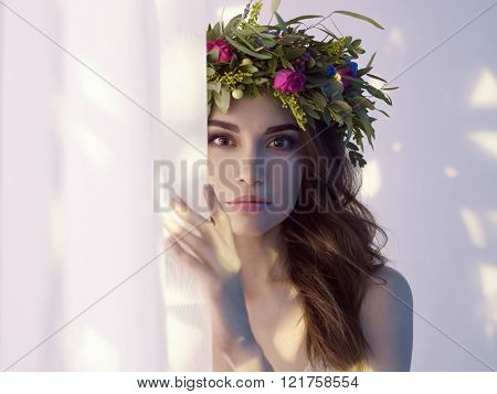 Fashion art photo of beautiful lady in flower diadem. Spring/Summer