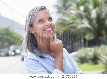 Laughing Caucasian Woman With Blue Blouse In A Park
