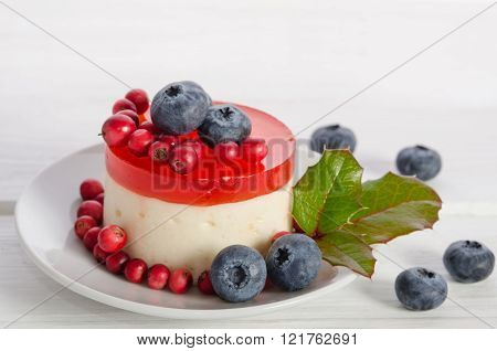 Fruitcake With Berries In Porcelain Saucer