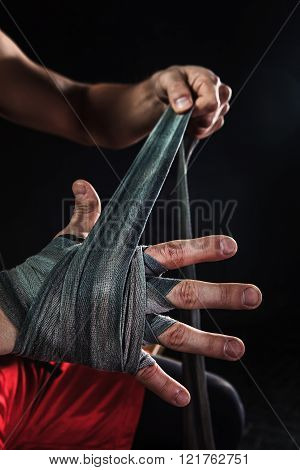 Close-up hands of muscular man with bandage