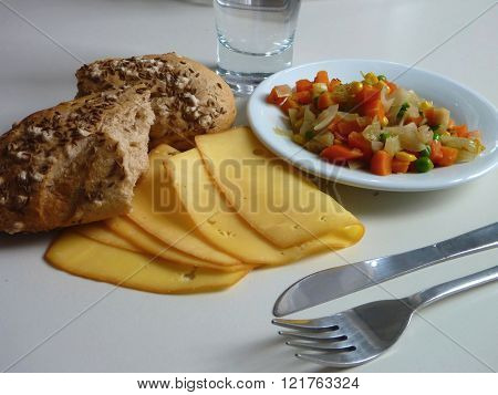 Cooked Vegetable Salad Served With Bread And Cheese