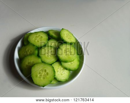 Sliced Cucumber Served On A White Plate