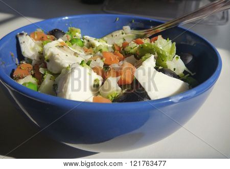 Vegetable Salad With Black Olives And Mozzarella