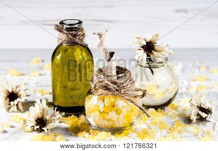 Spa, Bath Salt, Oil, Herbs On A Wooden Table