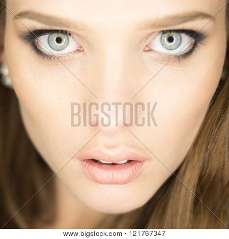 magnificent portrait of a beautiful young woman with perfect skin and blue eyes