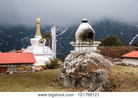Buddhist Places Of Worship - A Furnace For Burning Incense And Buddhist Stupa.