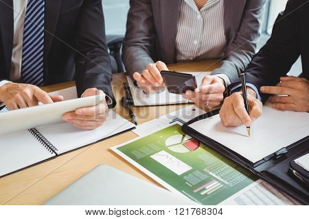 Businesspeople working in conference room in office
