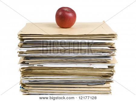 File Stack and red apple close up shot on white background