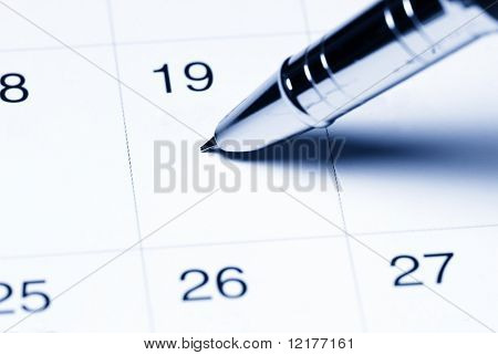 Calendar with pen