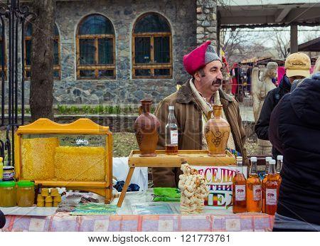 Man selling honey on Shrovetide Celebration in Zaporizhia