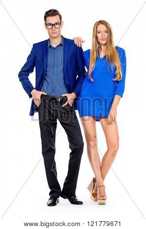 Full length portrait of young fashionable couple over white background. Isolated.