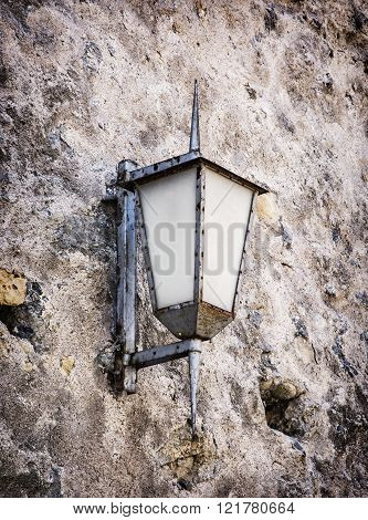 Vintage Street Lamp Hanging On The Old Wall