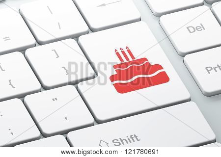 Entertainment, concept: Cake on computer keyboard background