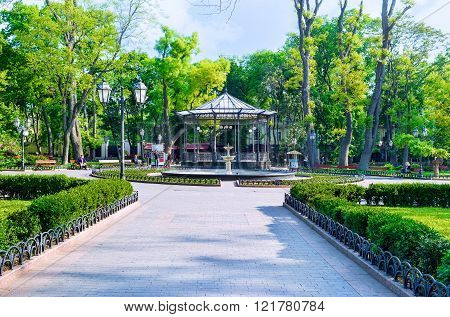 ODESSA UKRAINE - MAY 18 2015: The City Garden is the central park with a lot of benches in shade fountains and restaurants on May 18 in Odessa.