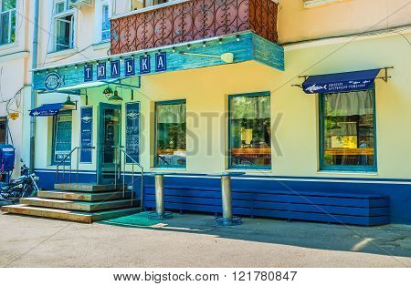 ODESSA UKRAINE - MAY 18 2015: The seaside town boasts a wide range of small fish taverns where clients could taste dishes with today caught fish on May 18 in Odessa.