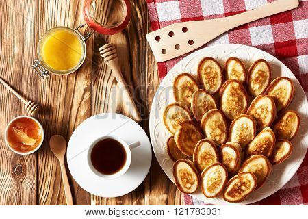 Homemade pancakes or fritters on wooden background