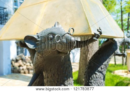 ODESSA UKRAINE - MAY 18 2015: The sculpture of the rats that hold the pyramid in the courtyard of the Odessa Literary Museum on May 18 in Odessa.