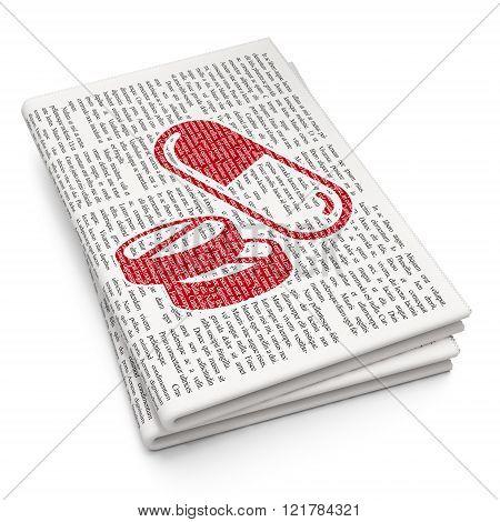 Medicine concept: Pills on Newspaper background