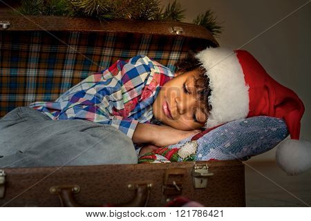 Happy black boy's Christmas sleep.