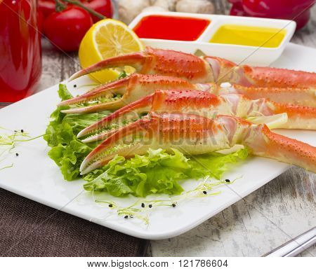 Boiled Crab Claws With Sauce , Lemon And Cherry Tomatoe With Tasty Drink Over Wooden Background
