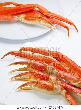 Boiled Crab Claws On A Plate Over White Background