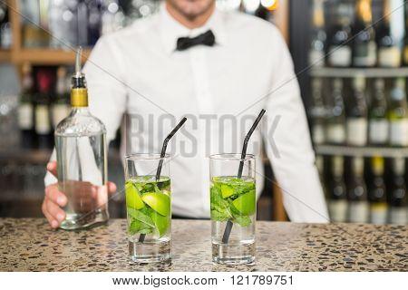 Bar tender making cocktails in a pub