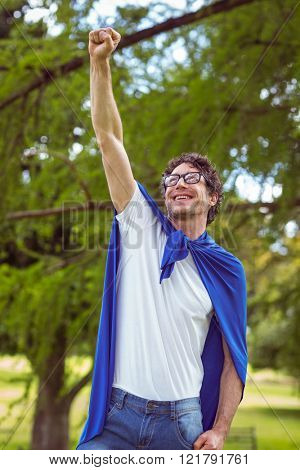 Man dressed as superman in the garden