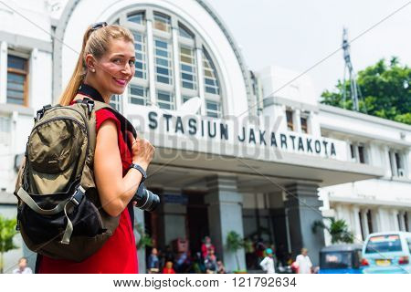 Woman at train station sightseeing in Jakarta, Indonesia standing on street
