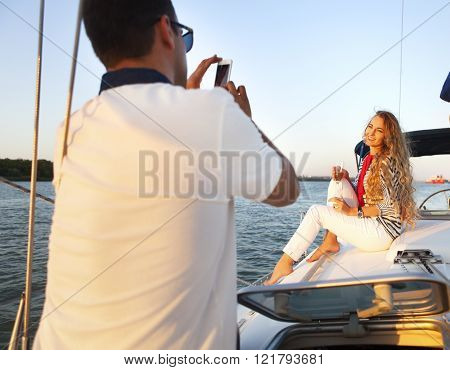 Beautiful Couple Taking A Photo On A Sailing Boat At Summer