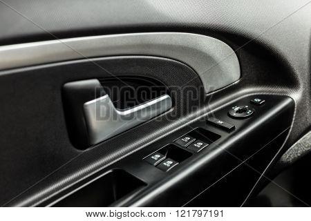 Car interior dark door panel close up