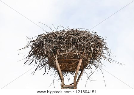 empty nest of storks on a lamppost
