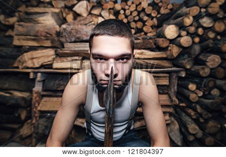 Man With An Ax Near Firewood Stock